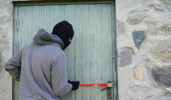 Burglar Trying To Break Into A House
